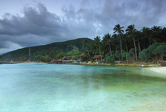 Candidasa Lagoon (tropicaLiving - Jessy Eykendorp) Tags: trees light sunset sea sky bali seascape beach nature water clouds indonesia landscape coast rocks coconut north shoreline lagoon palm east northeastern candidasa efs1022mm outdoorphotography canoneos50d tropicaliving hitechfilters vosplusbellesphotos rawproccessedwithdigitalphotopro tiffproccessedwithadobephotoshopcs3 candidasalagoon hitechfilterndgrad