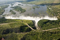 Victoria Falls from the Air, Victoria Bridge between Zambia and Zimbabwe (Marie-Marthe Gagnon) Tags: world africa bridge green up river high natural down victoria falls seven waterfalls zimbabwe gorge victoriafalls wonders zambia famine zambezi livingstone davidlivingstone sland 5f zambeziriver batoka mosioatunya smokethatthunders flickrchallengegroup flickrchallengewinner sevennaturalwondersoftheworld geoafrica mariegagnon mariemarthegagnon
