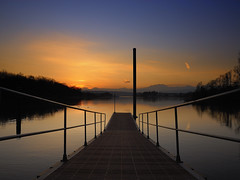 Headed For Freedom (Fabio Montalto) Tags: sunset italy river pier ticino soe amazingcolors sestocalende nikond200 flickrsbest mywinners platinumphoto aplusphoto ultimateshot excellentphotographerawards exemplaryshots theunforgettablepictures theperfectphotographer absolutelystunningscapes capturenx2 micarttttworldphotographyawards micartttt wagman30 spectacularsunsetsandsunrises flickrclassique flickraward platinumpeaceaward
