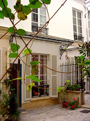 Chez moi-- porte d'entre (maralina!) Tags: paris home architecture apartment wroughtiron courtyard cobblestones 75006 welcome domicile bienvenue maison appartement fentre frontdoor cour marquise chezmoi pavs frenchwindow ferforg portedentre 6earrondissement