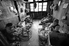India - Darjeeling, tibetan refugee. (luca marella) Tags: travel people blackandwhite bw india white black film work photo blackwhite women interiors room refugee free pb bn e tibetan bianco darjeeling nero freetibet marella marellaluca