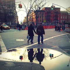 Hand in Hand (in Hand in Hand) (antonkawasaki) Tags: nyc newyorkcity reflection water puddle streetlights taxi streetphotography squareformat iphone redbuilding 500x500 leaflesstrees greenlightgo coupleinlove coupleholdinghands redlightstop stphotographia antonkawasaki twohandsbecomefour cornerofgreenwichavenueand13thstreet greenwichvillagescene rightlaneclosedsign inthestyleofsion