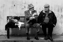 Chiacchiere (sgrazied) Tags: portrait blackandwhite bw primavera chat seat rimini canoneos20d silvia bologna ricordi ritratto talkin biancoenero oldmen romagna panchina chiacchiere racconti parlare vecchietti laureasilvia sgrazied interphoto