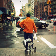 Four Wheels and a Leg (antonkawasaki) Tags: nyc newyorkcity injury streetphotography scooter squareformat iphone irregular orangejacket crossingthestreet 500x500 waitingforthelighttochange bummerdude stphotographia baginhand kneewalker antonkawasaki fourwheelsandaleg ponderingwheretogonext handtohip hardtomaneuver everyonestaring icantotallysympathizewiththisguy