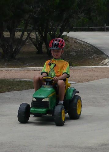 Carson riding down the White driveway