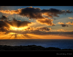 Midwinter!.. (Chantal Steyn) Tags: ocean light sun water clouds sunrise landscape coast nikon warm rays hdr d300 5exp 1685mm goughisland