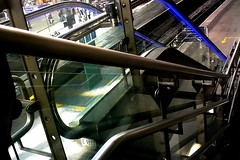heavy metal (Harry Halibut) Tags: blue station yellow stairs steel escalator central steps leeds angles stainless concourse allrightsreserved anglesanglesangles colourbysoftwarelaziness leeds090517a094 andrewpettigrew
