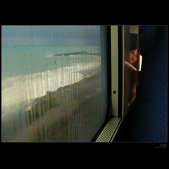 Rain Train (Osvaldo_Zoom) Tags: trip sleeping sea reflection window rain train journey commuter treno trenitalia reflecition