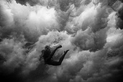 (SARA LEE) Tags: ocean bw abstract feet water girl silhouette female clouds hawaii underwater wave malia figure nightmare bigisland powerful kona sarahlee kobetich kohanaiki maliac surfhousing vivantvie