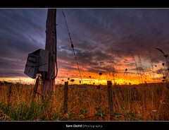 How much power does the world use? ([ Kane ]) Tags: road newzealand sky sun grass clouds fence wire farm hamilton pole kane hdr powermeter gledhill kanegledhill vosplusbellesphotos humanhabits kanegledhillphotography