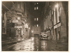 A wet Angel Place, Sydney, 1930s / Sam Hood (State Library of New South Wales collection) Tags: noir samhood streetscapes automobiles angelplace sydney buildings streetlamps rain wet street city old car crevilles statelibraryofnewsouthwales musicshop recordshop alley palings xmlns:dc=httppurlorgdcelements11 dc:creator=httpnlagovaunlaparty587349 cidade carro noite rua prédios comércio light perspective blackandwhite sepia plymouth noche nochelluviosa auto callejón oscuridad still peaceful