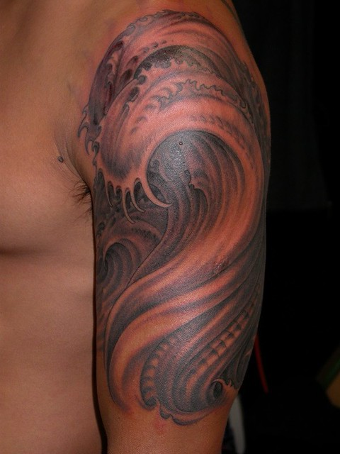 freehand wave tattoo. black and gray tattoo by Matthew Amey