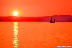 Sunset and Sailboat, East Haven, Connecticut (Jeff Wignall) Tags: sunset red orange yellow landscapes nikon pretty connecticut d70s thoughtful newengland week1 reflective nights newhaven sunrises sailboats mellow longislandsound easthaven wignall crepuscolosunsets