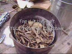 tlud smokeless stove (emil yanai) Tags: africa wood camping camp shells green cooking ecology project outdoors tin fire technology outdoor refugee nuts straw can chips gas stove cans twigs humanitarian dung ecological biomass pellets paal efficient cookstove fuels smokeless nutshellls gasification gasifier woodgas wendelbo pekope pyrolisis effificiency tlud