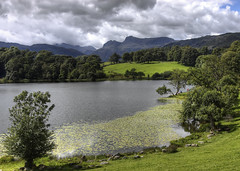 England: Cumbria - Loughrigg Tarn (Tim Blessed) Tags: uk sky mountains nature water clouds landscapes countryside scenery lakes lakedistrict cumbria singlerawtonemapped
