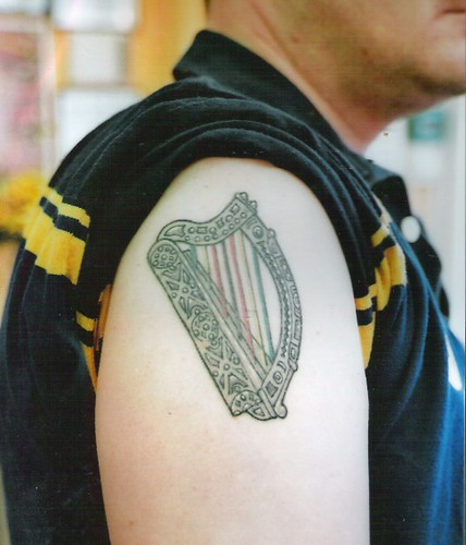 Irish harp with Zimbabwe colors in strings by dublin ireland tattoo artist