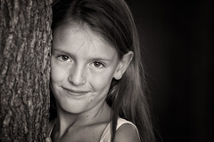 Smiling (Delano365) Tags: portrait bw cute girl smile kids canon eyes child bokeh headshot grin alienbee softbox onelight pocketwizards 40d softlighter ab400 d365 silverefex