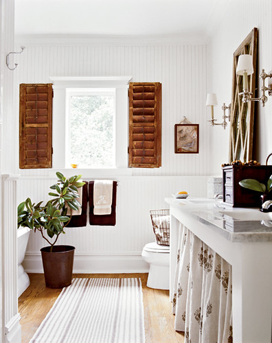 Classic white bathroom with tropical decor: Red oak floors + hummingbird fabric