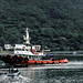 Cycle Tour of Chile & Argentina - Tug under way to assist freighter entering Puerto Montt