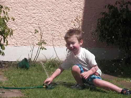 Nathan in the sprinkler 2009