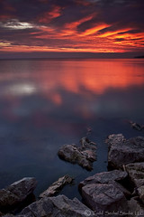 Morning Warning. (tsechel) Tags: morning ohio sky lake reflection water sunrise rocks lakeerie greatlakes lorain 1740f4l loraincounty singleexposure nothdr abigfave canon50d leefilters anawesomeshot skytheme lakesidelanding 6nd 6gnd 9gnd