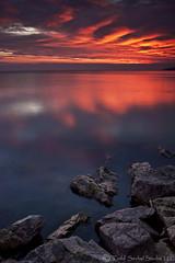 Morning Warning. (tsechel) Tags: morning ohio sky lake reflection water sunrise rocks lakeerie greatlakes lorain 1740f4l loraincounty singleexposure nothdr abigfave canon50d leefilters anawesomeshot skytheme