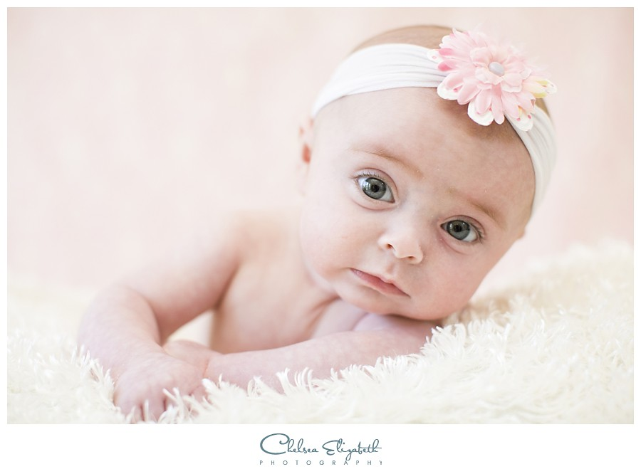 newborn portrait with pink damask backdrop