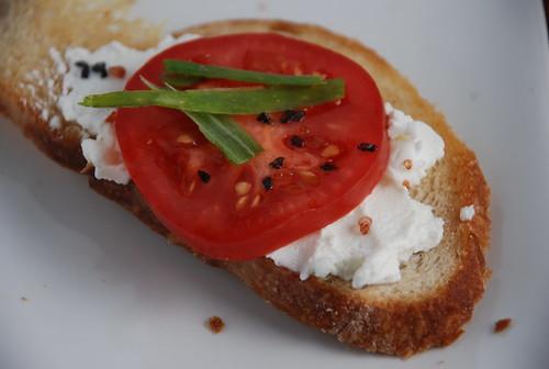 my favorite appetizer: crostini with soft chevre, overripe tomato, good salt