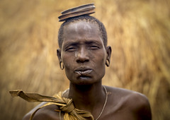 Mursi woman with lip cut Omo Ethiopia (Eric Lafforgue) Tags: africa woman broken girl artistic dam wounded culture hasselblad explore ornament clay lip bodypainting tradition ethiopia rite barrage mursi bodymodification labret adornment pigments omo eastafrica thiopien blesse etiopia ethiopie etiopa h3d lafforgue  omorate etiopija ethiopi  lipplug lipplate etiopien etipia  etiyopya  nomadicpeople    a705889 salinicostruttori    gibeiiidam gibe3dam bienvenuedansmatribu peoplesoftheomovalley lipdisclipplate piercedhole piercedlipornament