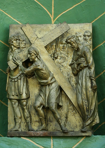 V. Simon of Cyrene carries the cross