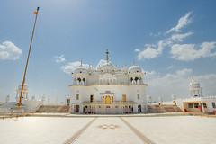 Sri Kesgarh Sahib (Angad) Tags: blue sky panorama india white clouds canon temple 350d place image religion panoramic holy sri marble sikh sahib punjab gurudwara verticalstitch sikhi angadwashere nishaan anandpur anandpursahib nishaansahib kesgarh srikesgarhsahib