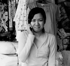 . (Out to Lunch) Tags: street woman blackwhite downtown phone market candid cell vietnam business ba hai trung saigon earthasia