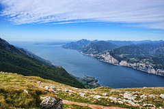 Lake Garda, Italy (sminky_pinky100 (In and Out)) Tags: travel blue sky italy mountain lake green tourism yellow clouds landscape high rocks europe pretty scenic picturesque malcesine overview lakegarda montebaldo