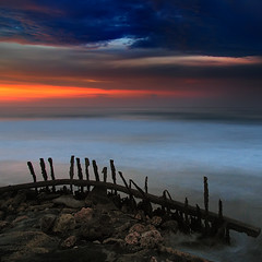 Ruins (Carlos Gotay Martnez) Tags: sunset sea sky metal clouds canon rust ruins stones corroded superaplus aplusphoto platinumheartaward