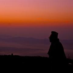 Nepali sunrise (DarrenWilch) Tags: morning nepal light red summer sky orange mist water hat sunrise photo amazing himalaya nepali