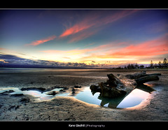 The Stump (Land of the long white cloud) ([ Kane ]) Tags: newzealand sky reflection tree beach sand explore nz stump kane hdr gisborne gledhill waikanaebeach kanegledhill vosplusbellesphotos humanhabits kanegledhillphotography