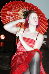 Violet in Red (World of Oddy) Tags: red performance cardiff violet parasol burlesque violetnoir 10feettall cardiffburlesque returntofannystreet