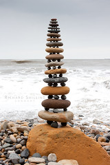 Robin Hood's Bay Pebble Stack (escher is still alive) Tags: sea sculpture colour tower beach march spring sandstone yorkshire cliffs stack 2009 ephemeral northyorkshire landart naturalart enviro robinhoodsbay sculpure rockbalancing pebblebalancing enviroart andygoldsworthyhomage richardshilling