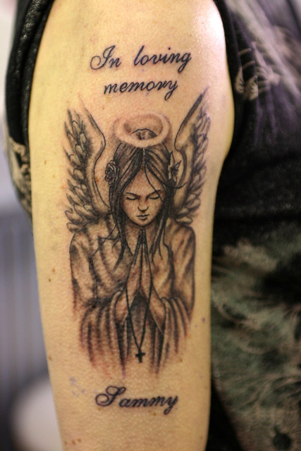 An in loving memory tattoo is usually put on the back of the shoulder,
