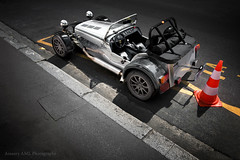Caterham (Amaury AML) Tags: auto street light sunlight paris reflection art cars car racetrack race speed canon photo shot lotus shots pavement wheels 7 polish automotive super voiture exotic chrome seven polarized rue supercar caterham cr exotics supercars outstanding amaury superlight chromed aml 40d cr500