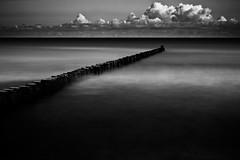Groyne (96dpi) Tags: wood longexposure sea blackandwhite bw beach clouds strand warnemnde meer wolken baltic erosion sw schwarzweiss holz groyne ostsee rostock buhne kstenschutz hydraulicstructure