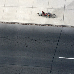 Alone on Adelaide [explored} (red_dotdesign) Tags: toronto bicycle grid pattern squares pavement empty sidewalk locked cracked