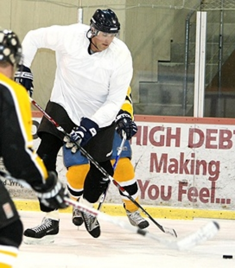 Tag playing hockey