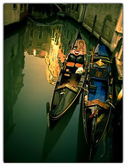 Solitary Gondolas (Martjusha) Tags: venice light italy black colour detail verde water canal italia colours colore afternoon giallo gondola acqua rosso venezia venedig nero luce canale scorcio gondole dettaglio pomeriggio   martjusha