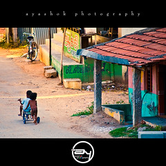 Childhood days (ayashok photography) Tags: childhood kids nikon cycle eveninglight nikonstunninggallery nikond40 ayashok paramakudi nikor55200mm