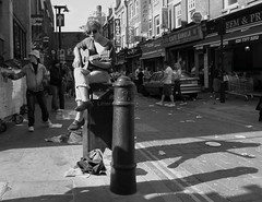 For the times they are a changing (Ian Brumpton) Tags: street blackandwhite bw dylan blancoynegro blackwhite noiretblanc guitar candid livemusic streetportrait londres streetperformer bricklane busking littlebritain keepbritaintidy streettheatre thetimestheyareachanging londonstreetphotography blackwhiteemotions livinginaheartshapedworld aimlessstrolling disposablepop theresaholeinmyshoeanditslettinginwater aimlessstrumming