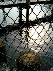 Behind The Fence (jackiegee01) Tags: reflection marina fence newjersey dock jerseyshore oceancounty tomsriver