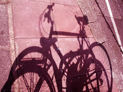 On yer bike (Christoph Christoph) Tags: road shadow bike silhouette brighton pavement adifferentpointofview
