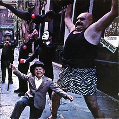 The Doors -- Strange Days (1967) (album cover) -- songs by Jim Morrison, Robby Krieger, Ray Manzarek, and John Densmore.