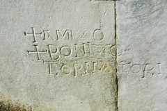 Inscription on the Duomo in Pisa (Crumblin Down) Tags: park santa plaza blue italy tower church monument field saint st del square religious words italian italia cathedral maria basilica mary gothic medieval pisa campanile tuscany latin campo piazza duomo miracles leaning santo assumption baptistry baptistery lean miracoli assunta camposanto